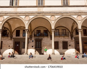 FLORENCE, ITALY: Social distance of people of italian city on sunny day under historical house arches on September 25, 2019. Old Florence is UNESCO World Heritage Site