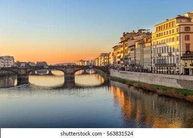 Florence, Italy, sunset view from Ponte Veccio on the river Arno and Ponte Santa Trinita, a Renaissance bridge, the oldest elliptic arch bridge in Europe.