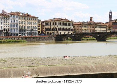 Florence, Italy view from Arno River - sunbathing