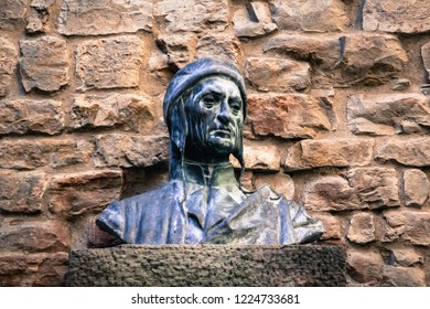 Florence, Italy-13.06.2017-Sculpture monument of famous italian poet Dante Alighieri, in front of Dante House in Florence