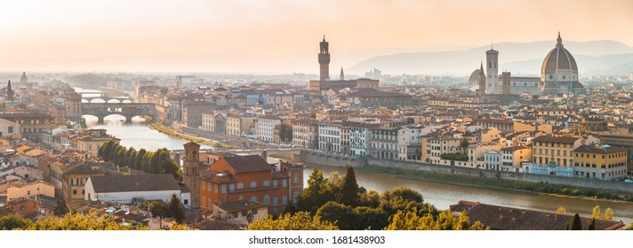 Florence panoramic aerial view  at sunset - From left to right there are Ponte Vecchio, Palazzo Vecchio and Santa Maria del Fiore cathedral - travel and architecture in Italy