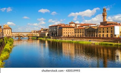 Florence, Ponte Vecchio bridge over river Arno and Palazzo Vecchio (Tuscany, Italy)