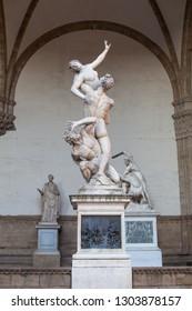 Florence sculpture of The Rape of the Sabine Women (Ratto delle Sabine) by Giambologna in Loggia dei Lanzi on Piazza della Signoria, Florence, Italy. Firenze landmarks
