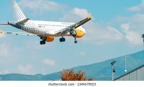 FLORENCE - SEPTEMBER 2, 2015: Vueling airplane lands in Peretola airport. Vueling is a spanish low-cost airline with some 87 planes in operation.