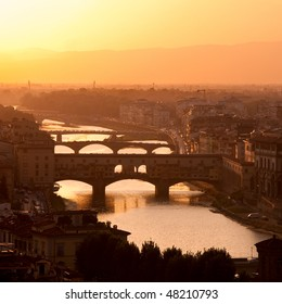 Florence skyline at sunset, Italy. Ponte Vecchio sull'Arno.