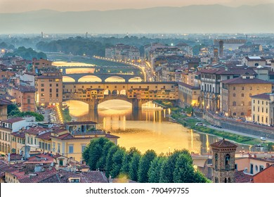 Florence sunset city skyline and Ponte Vecchio Bridge, Florence, Italy