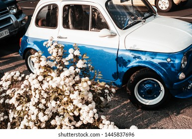 Florence Tuscany, Italy Europe - circa April 2017 - Fiat 500 last century vintage car parked in a country yard environment. 1950 1960 1970 1980 1990