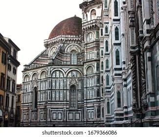 Florence, Tuscany, Italy- February 2020  Side street view of the Duomo of Florence at sunrise