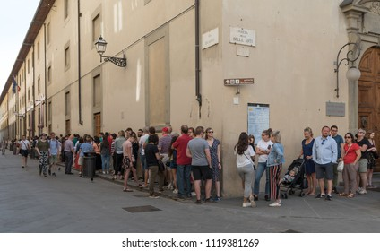 Florence, Tuscany, Italy - June 3 2018: Long line of people queuing in front of famous Galleria dell'Accademia, visitors wait in line to see the original statue of David by Michelangelo