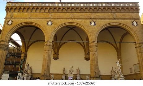 Florence, Tuscany, Italy - March, 2019. View of the Loggia dei Lanzi, also called the Loggia della Signoria, a building on a corner of the Piazza della Signoria in Florence, Tuscany, Italy