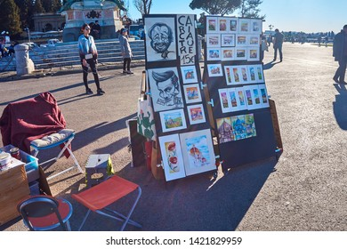 Florence, Tuscany  Italy. - March 2019. Street artists and paintings on the square in Florence, Italy, Europe.