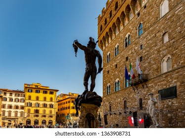 FLORENCE, TUSCANY, ITALY - March 31, 2019: Statue of Perseus with the head of Medusa by Benvenuto Cellini and beside Palazzo Vecchio in the historic center World Heritage Site.