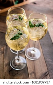 Florence, Tuscany / Italy. - May 4, 2018. Three glasses of Prosecco white wine in a large glass with ice and mint leaves in a bar in Florence
