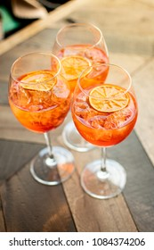 """Florence, Tuscany / Italy.- may 6,2018. Italian aperitif-citrus cocktail """"aperol spritz"""" with ice and a slice of orange"""