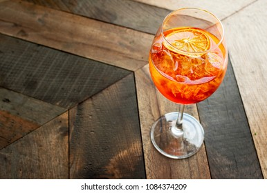 "Florence, Tuscany / Italy.- may 6,2018. Italian aperitif-citrus cocktail ""aperol spritz"" with ice and a slice of orange"