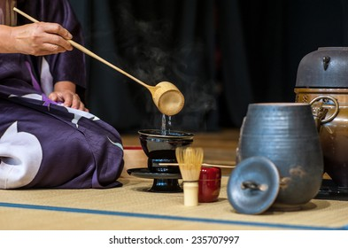Florence, Tuscany, Italy - November 15, 2014: japanese woman during the tea ceremony demonstration