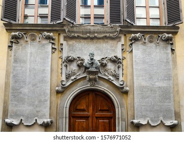 Florence, Tuscany / Italy - October 19 2019: Façade of Palazzo dei Cartelloni, also know as Palazzo Viviani, a Baroque palace with big epigraphs, hence the name, and a bust of Galileo Galileo