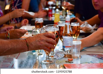 Florence, Tuscany / Italy. - October 5, 2018. glasses of beer on a table in a bar, hands of people, a party with friends