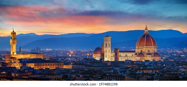 Florence, Tuscany, Italy. Panorama Sunset view at Duomo Santa Maria del Fiore cathedral and Palazzo Vecchio Tower. Panoramic View of Firenze during sunset. Scenic landscape mountains evening sky.