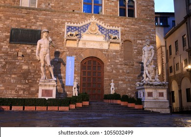 Florence, Tuscany, Italy - September 13, 2018: Hercules and Cacus statue from Giambologna and a copy of David of Michelangelo in front of the Palazzo Vecchio on the Piazza della Signoria