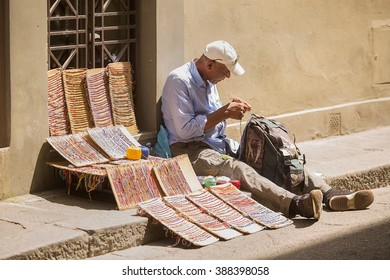 Florence-Italy, May 30, 2015. Street vendor selling handmade items on the streets of  Florence, Italy