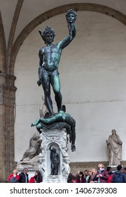 Florence,Tuscany/ Italy - April 11, 2018: People looking at Perseus with head of Medusa in Loggia de Lanzi, Piazza della Signoria.