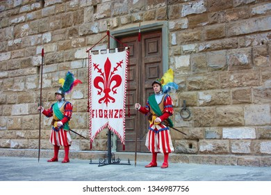 Florence,Tuscany/ Italy - March 3 2019 : uffizi flag. flag wavers of the city of florence, historical and cultural city of tuscany, italy.