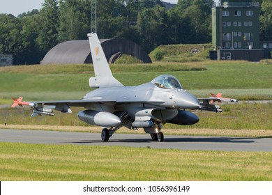 FLORENNES, BELGIUM - JUN 15, 2017: Belgian Air Force F-16 fighter jet plane taxiing to the runway of Florennes airbase.