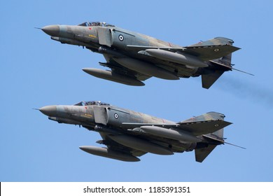 FLORENNES, BELGIUM - JUN 15, 2017: Two Greek Air Force F-4E Phantom fighter jets in formation flight.