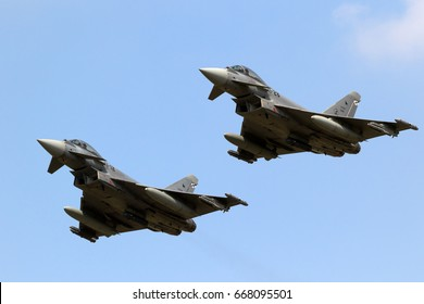 FLORENNES, BELGIUM - JUN 15, 2017: Two Spanish Air Force Eurofighter Typhoon fighter jets flyby.