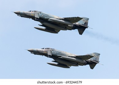 FLORENNES, BELGIUM - JUN 15, 2017: A McDonnell Douglas F-4 Phantom fighter jet of the Hellenic Air Force flies over the Florennes Airbase in Belgium.