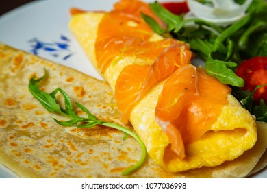 Florentine omelet with salmon, cream cheese and spinach on a plate