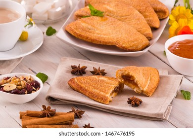Florentines sweet puff pastries on white dish.