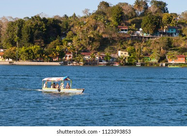 Flores, Guatemala - 2017-03-03: Boat on Lake Peten Itza in late afternoon, Guatemala, Central America