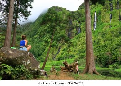 FLORES ISLAND, 12 AUGUST 2017 - Tourists admiring  Pozo da Alagoinha, also known as Pozo Ribeira do Ferreiro, Azores, Portugal, Europe