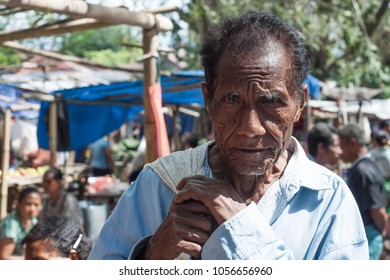 FLORES ISLAND, INDONESIA, 2012-04-18: portrait of old man walking through the local street market