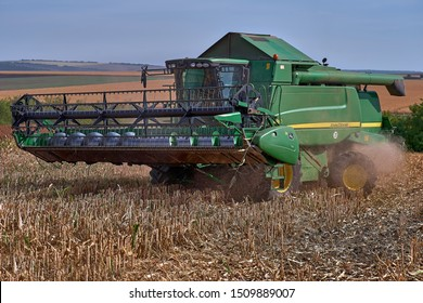 Floresti, Moldova. September 11, 2019: Green Harvesting working on a sorghum filed. Harvest season in raion of Floresti, Moldova