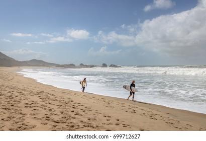 FLORIANOPOLIS, BRAZIL - Aug 13, 2017: Surfers at Praia Mole (Mole Beach) - Florianopolis, Santa Catarina, Brazil