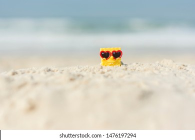 Florianopolis - Brazil, August 09, 2019:  SpongeBob SquarePants relaxing on the beach with heart sunglasses.