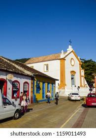 Florianopolis, Brazil - Circa August 2018: Typical colonial (Portuguese) houses and church in Santo Antonio de Lisboa village, tourist destination in Florianopolis
