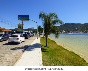 Florianopolis, Brazil - Circa August 2018: Cars at Rendeiras Avenue in Lagoa da Conceicao, popular tourist destination in Florianopolis