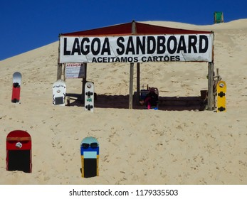Florianopolis, Brazil - Circa August 2018: Tent that offers sandboard rides on the sand dunes at Lagoa da Conceicao, popular tourist destination