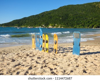 Florianopolis, Brazil - Circa May 2018: Colorful sandboards at Ingleses beach. Popular sport in that location, because there are big sand dunes by the beach.