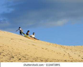 Florianopolis, Brazil - Circa May 2018: Family having fun on the sand dunes at Ingleses beach