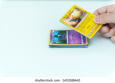 Florianopolis, Brazil, July 13, 2019: close-up of a man hand holding Pokemon Cards. Brazilian youths perform battles using these collectibles cards.