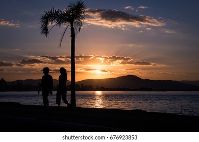 Florianopolis, Brazil - June 06, 2015: Sunset by the sea in Florianopolis, Brazil, with the silhouette of a person walking on the foreground.