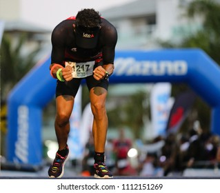 FLORIANOPOLIS, BRAZIL - MAY 27, 2018: Athlete celebrates after crossing the finish line of Ironman Brazil