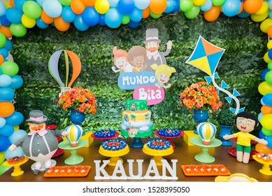 Florianopolis - Brazil, October 2, 2019: Children birthday table with a fake cake, candies and characters from Bita World. Colorful theme for kids party.