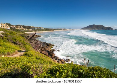 FLORIANOPOLIS - Santa Catarina - BRAZIL - 11-06-2020: Located in the north of the island of Santa Catarina, Praia do Santinho has an exuberant nature and is sought after by surfers and tourists.