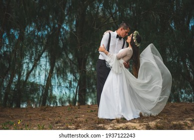FLORIANOPOLIS, SANTA CATARINA, BRAZIL - DECEMBER, 2017 -couple in love on the beach, beautiful photos in the forest landscape. Wedding pictures